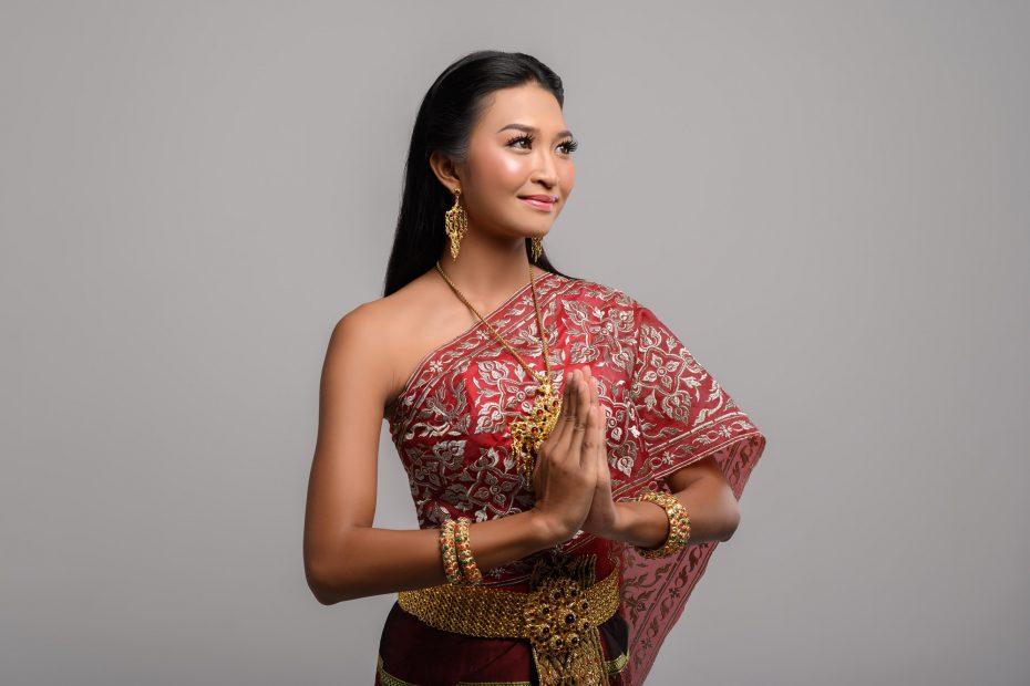 Women wearing Thai clothing that Pay respect,sawasdee symbol
